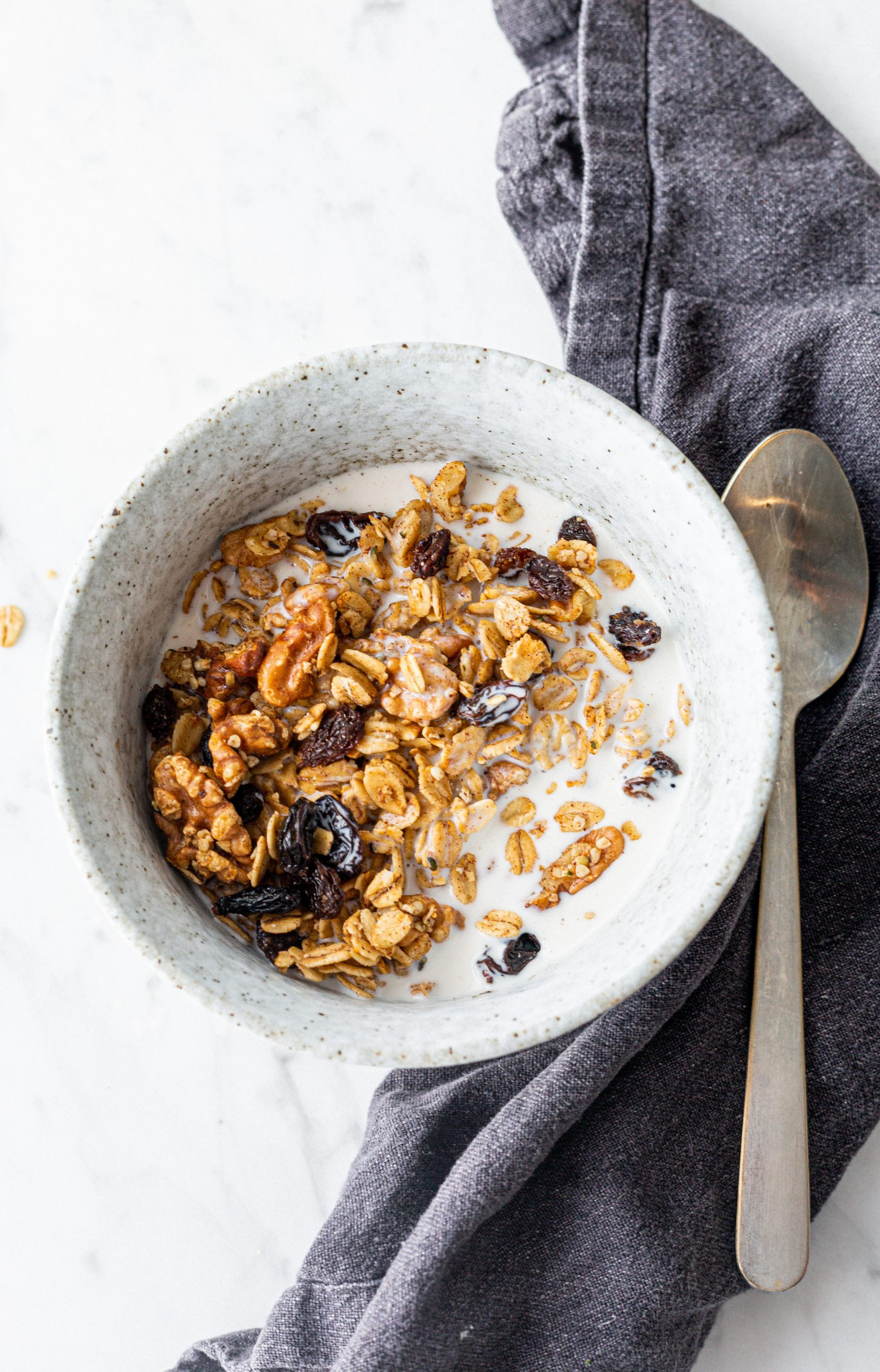 pumpkin spice gluten-free granola with raisins and walnuts