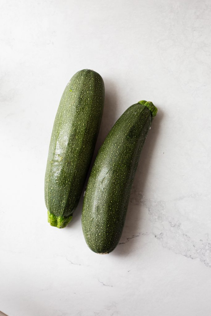 two zucchinis on a counter top